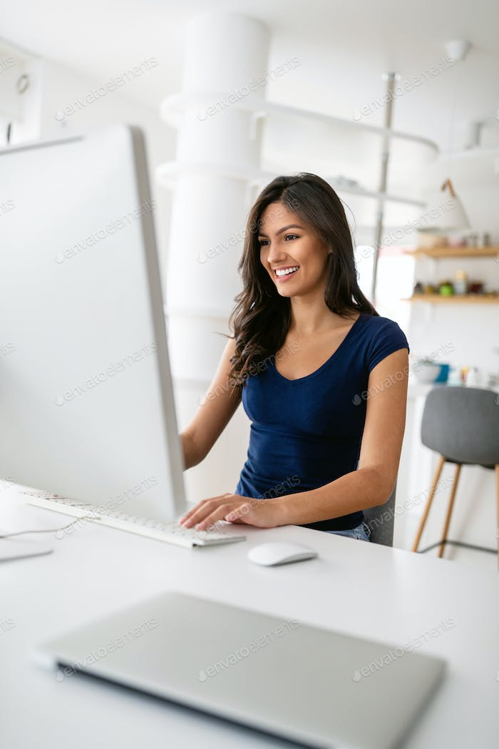 Beautiful happy woman working on computer. Technology business education social network concept
