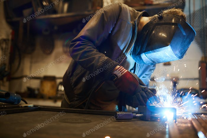 Welding iron workpieces