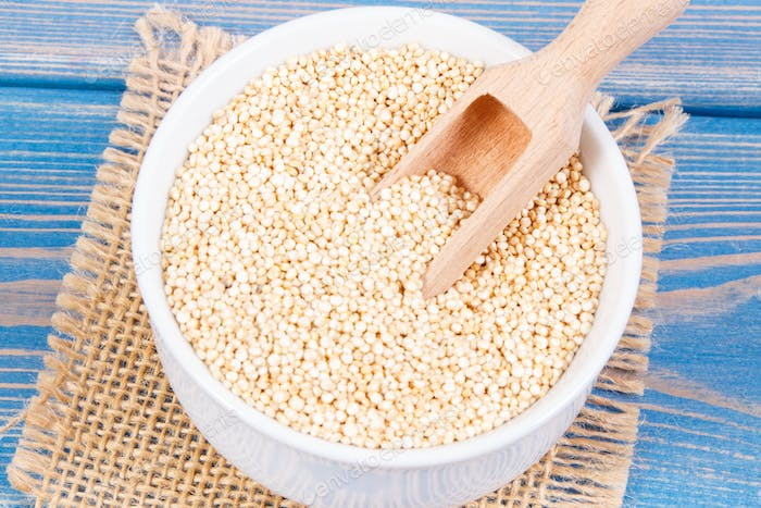 Quinoa seeds containing natural minerals and vitamins, concept of healthy nutrition