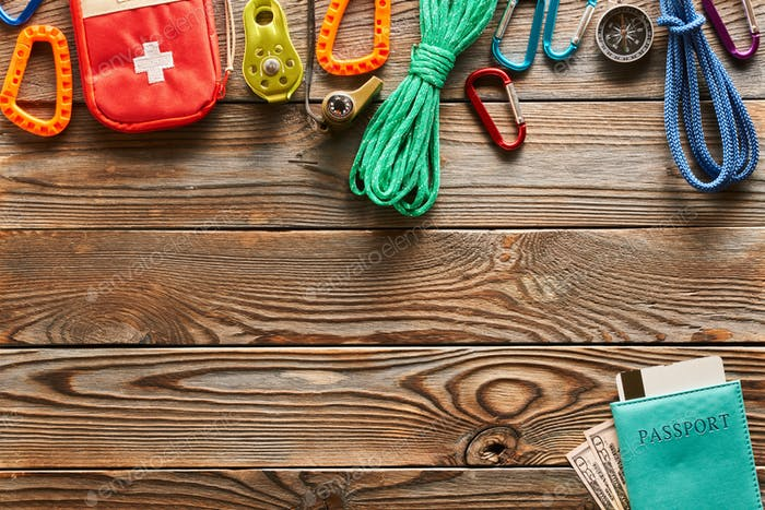 Travel items for hiking over wooden background