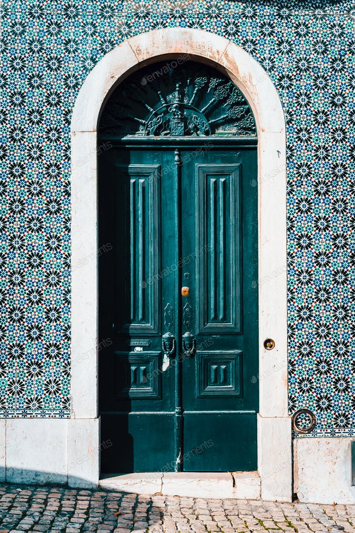 detail of portuguese architecture in Lisbon: Old tradition colorful door of the house in Lissabon
