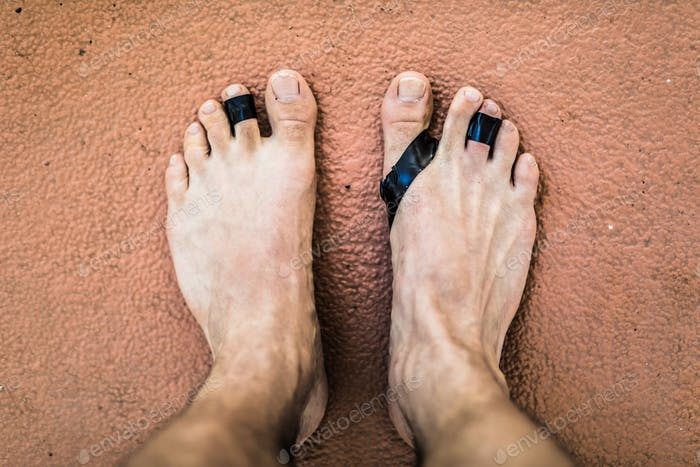 From above damaged feet of freediving man.