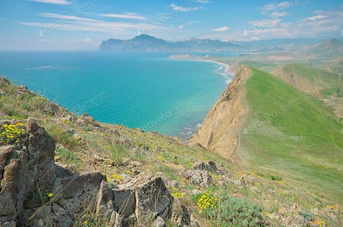 Spring mountain and sea shore bay.