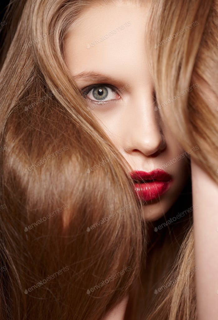 Hairy blond woman with red lips.