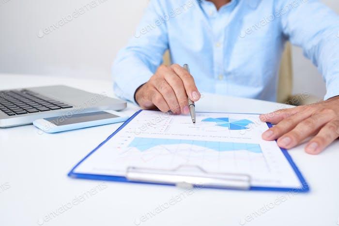 Business executive analyzing diagram