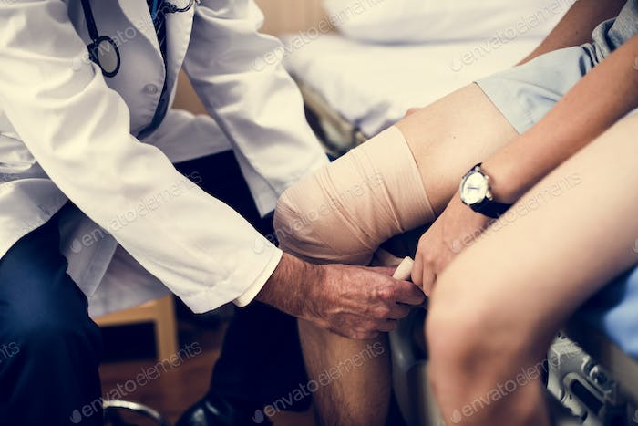 Doctor assisting a patient