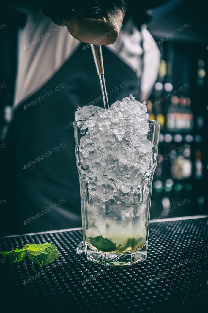 Barman is pouring alcohol