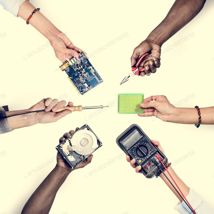 Group of hands holding computer electronics parts isolated on white