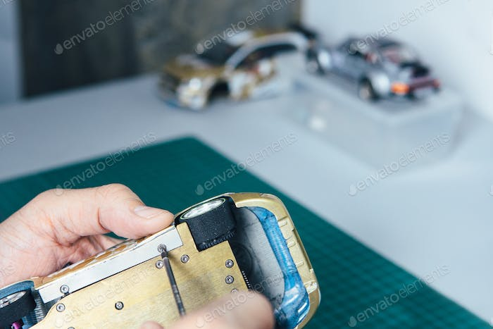 Person spinning screwdriver making slot car