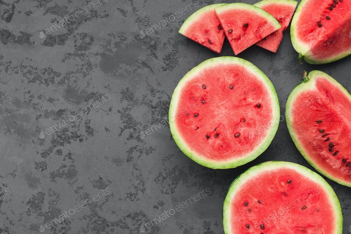 Cut fresh juicy watermelon on dark grey table