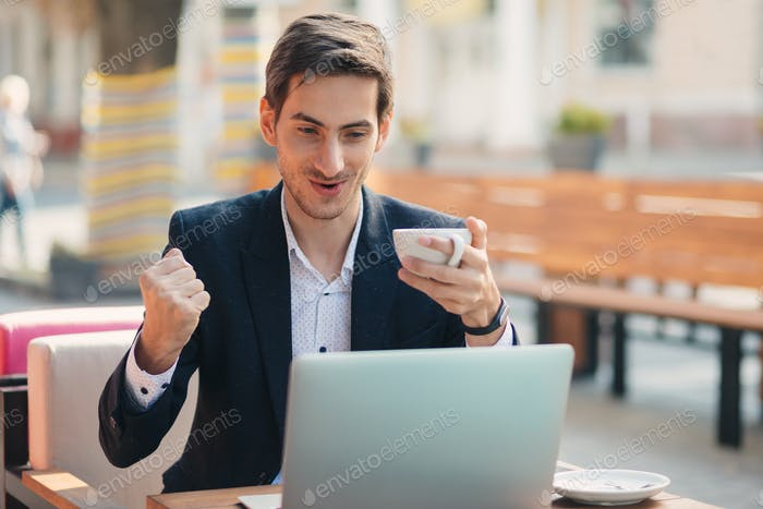 Man winner look with laptop
