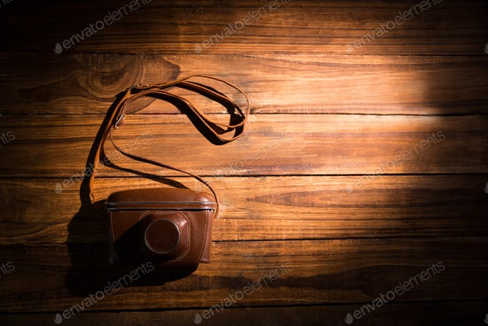 A camera on the wooden table at the office