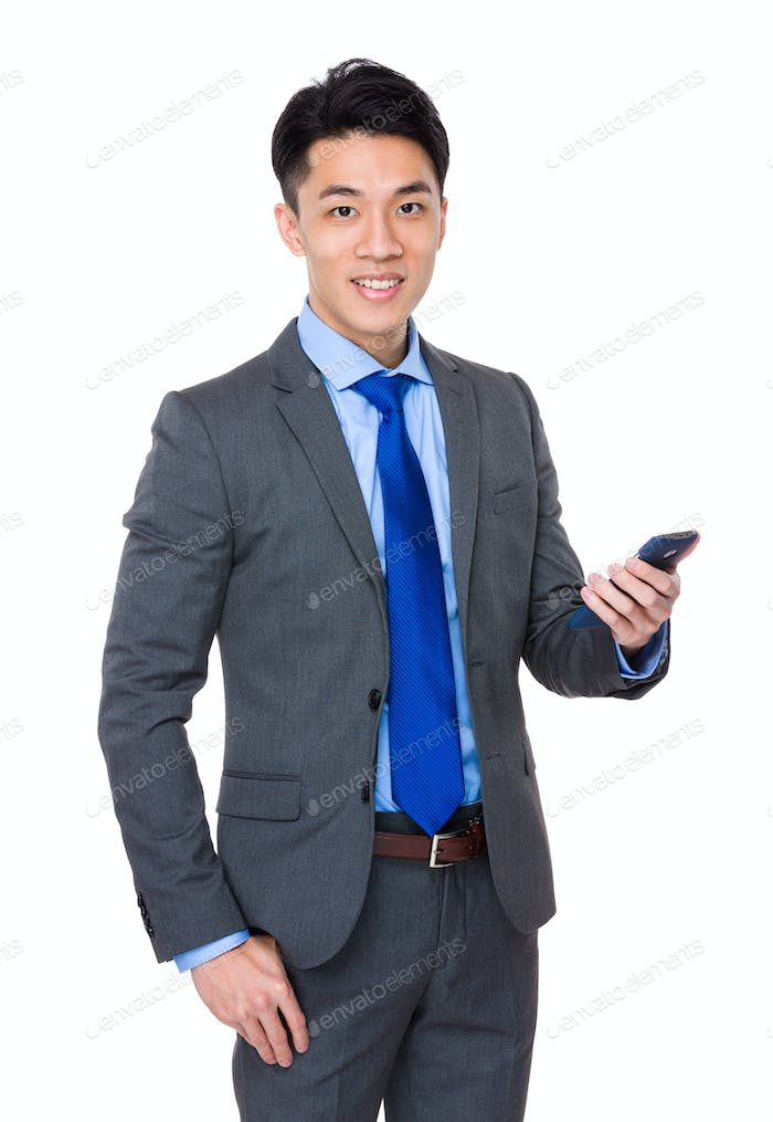 Asian businessman hand hold with smartphone