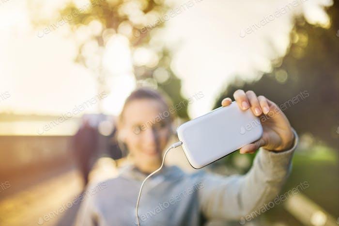 Mujer corredor Encantador selfie