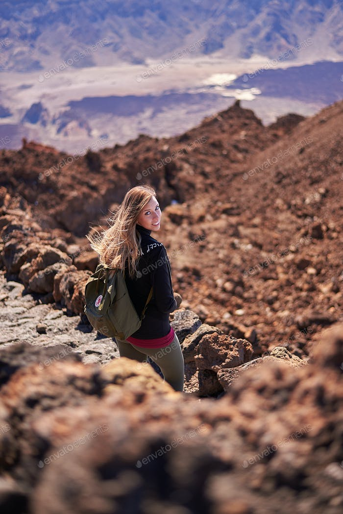 Young woman hiking the Teide mountain in Tenerife, Spain