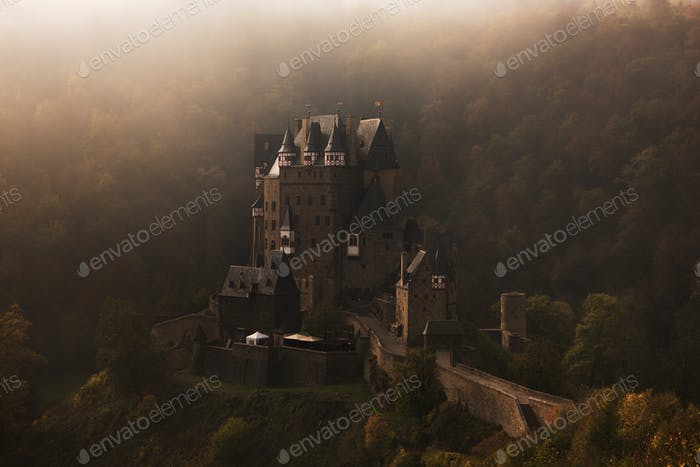 Burg Eltz castle in the early morning fog