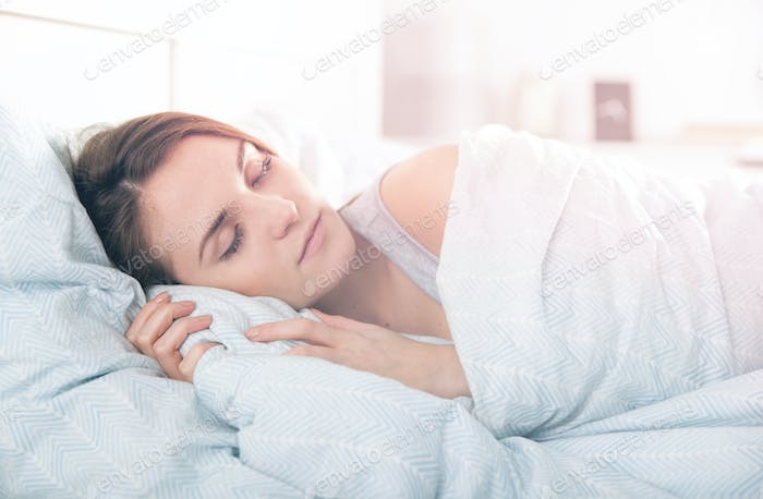 Girl peacefully sleeping in the morning before waking up