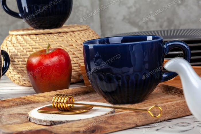 Still life photo of empty tea cup with honey spoon