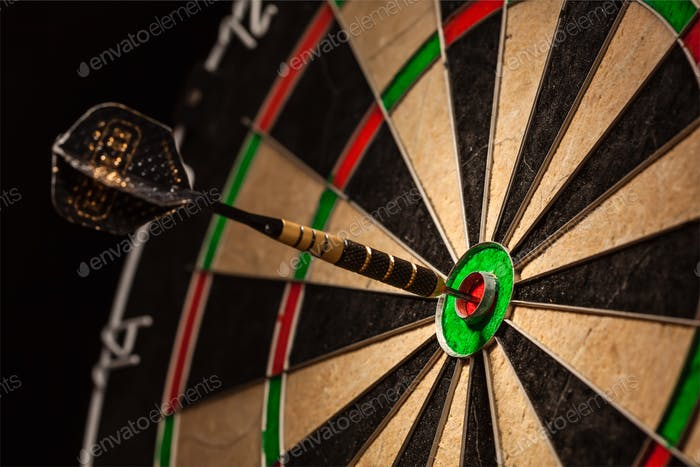 Dart in bull's eye close up