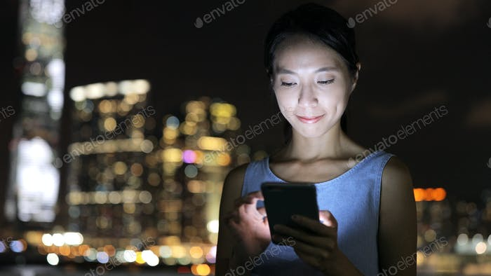 Young woman using cellphone in Hogn Kong