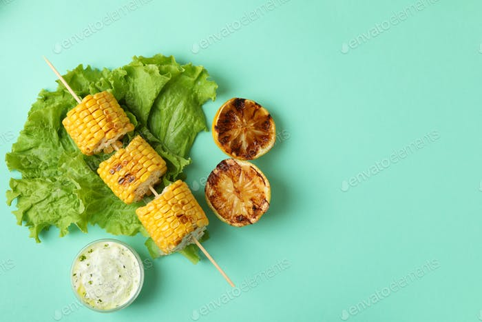 Concept of tasty food with grilled corn