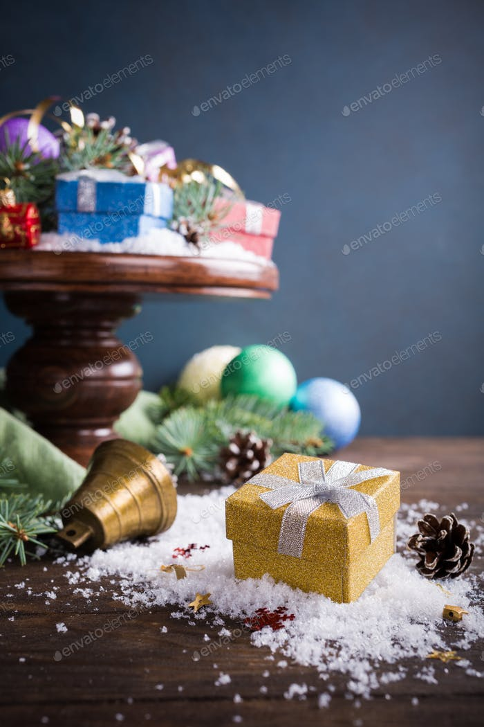 Gifts with christmas decoration on wooden cake stand
