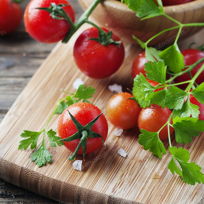 Fresh red tomato with green parsley