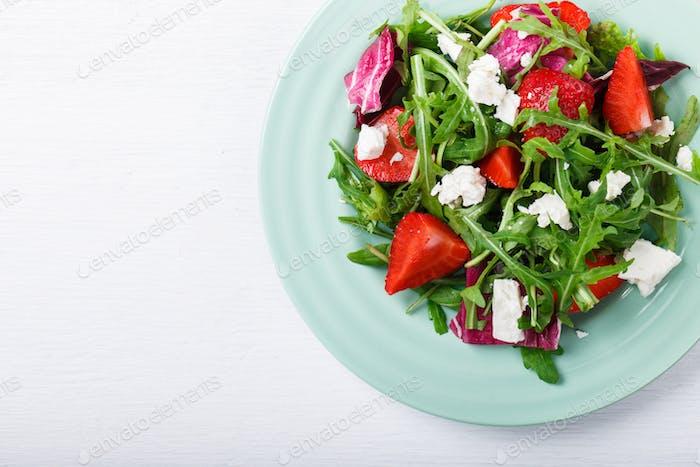 Salad of fresh strawberries,arugula,lettuce