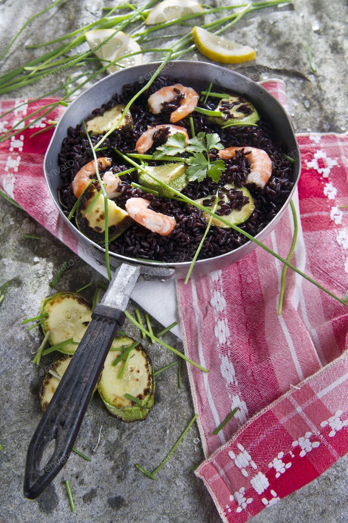 Black rice with shrimp and zucchini