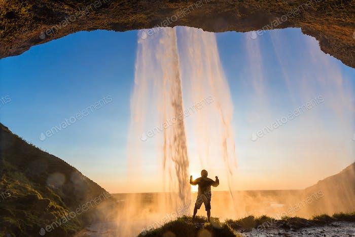 Man behind Seljalandsfoss Waterfall, South Iceland, Iceland