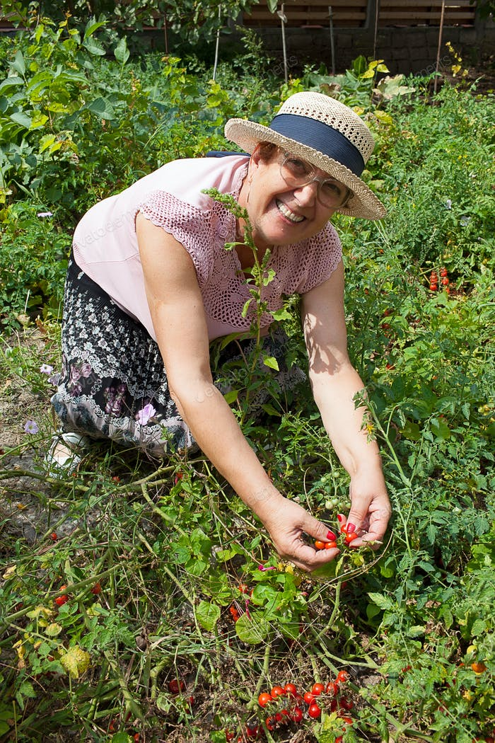 Cheerful Senior Woman Gardening