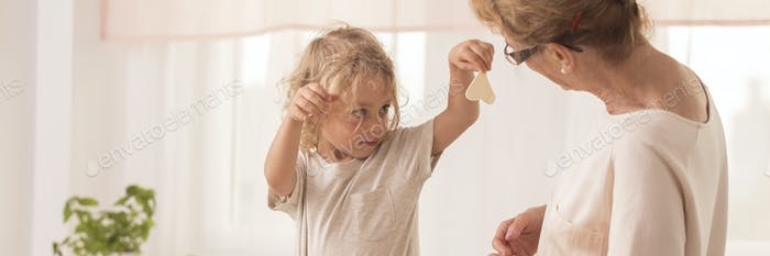 Boy making cookies with grandma