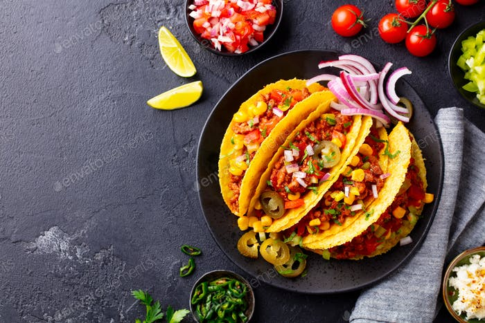 Taco with Beef, Mexican Traditional Cuisine. Dark Background. Copy Space. Top View.