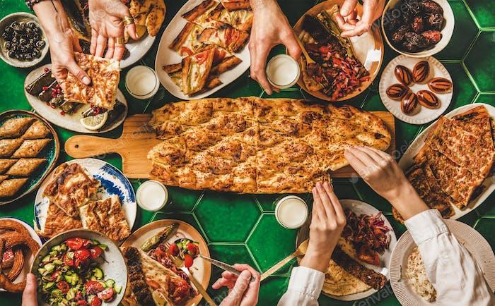 Muslim Ramadan iftar family dinner with Turkish foods and ayran