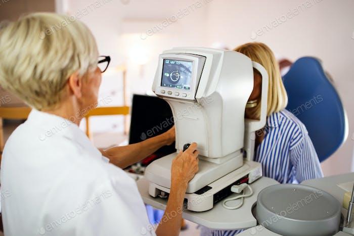 Ophthalmology eyesight diagnostic concept. Modern eye test machine equipment in clinic
