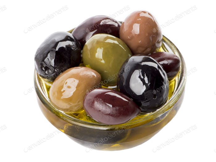 Bowl of different types of olives and olive oil
