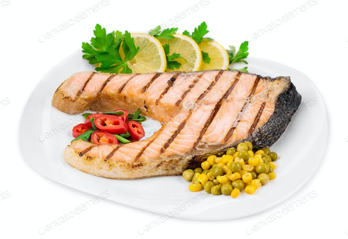 Grilled salmon steak with vegetables.