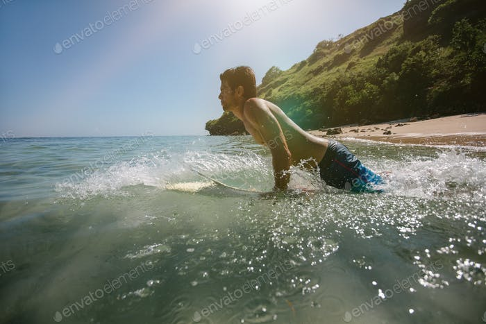 Young man doing water surfing in sea
