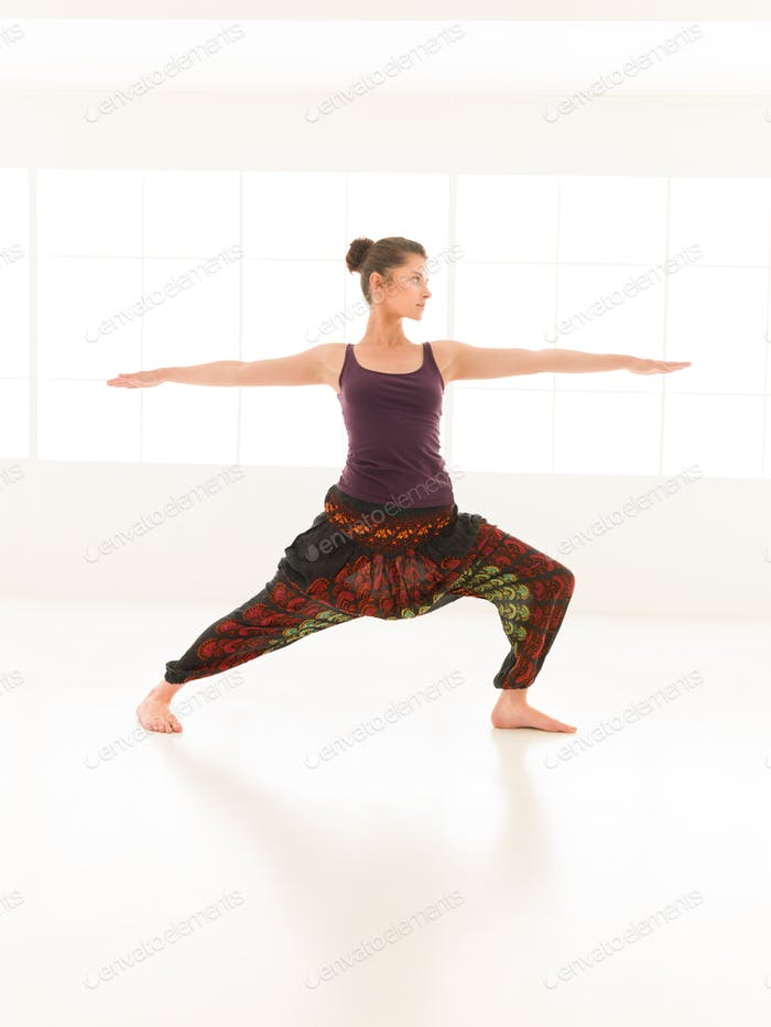 yoga pose variation, demonstrated by young female instructor