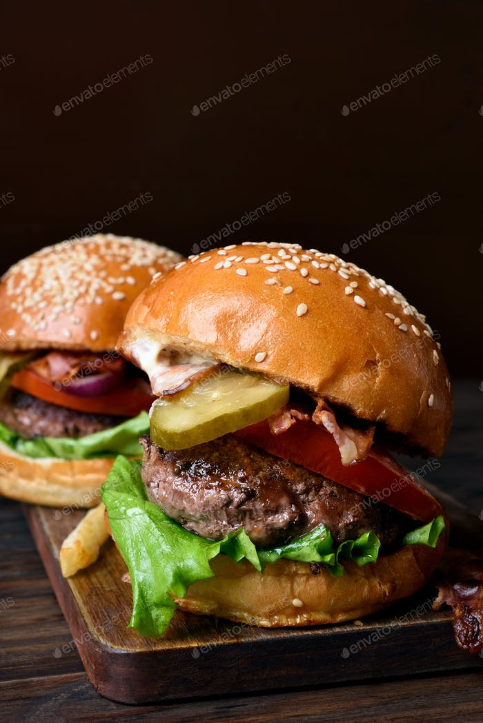 Tasty hamburger on wooden board