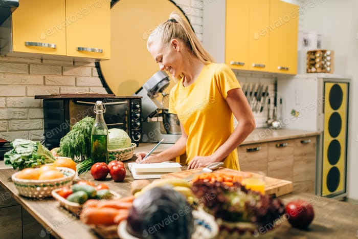 Female person cooking on the kitchen, organic food