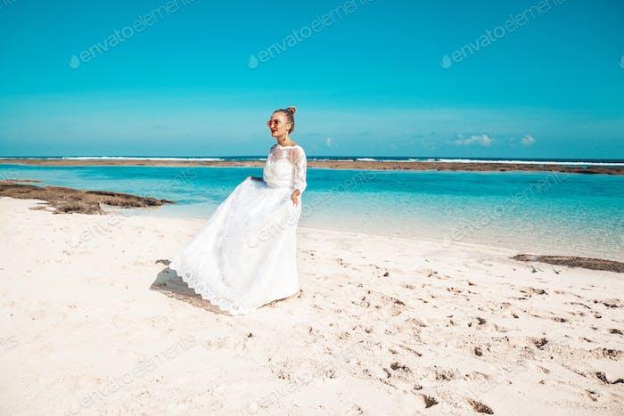Beautiful bride dancing at the beach