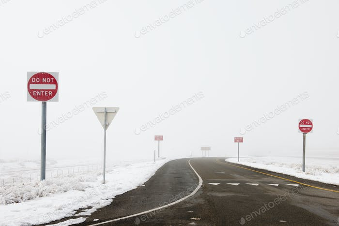 'Do Not Enter' Signs by Snowy Road