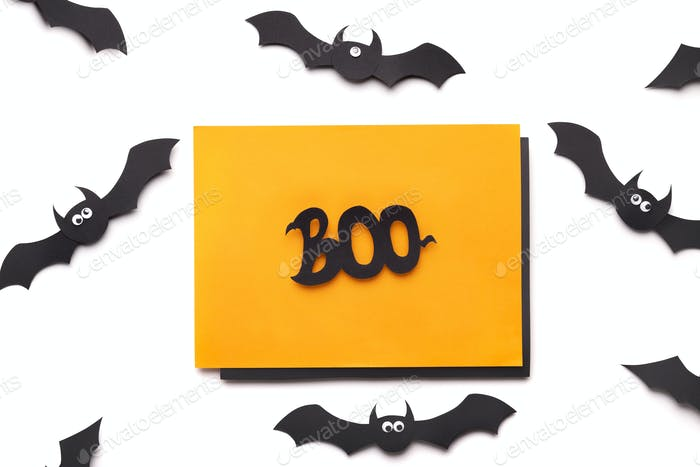 Creative autumn holiday background of paper bats