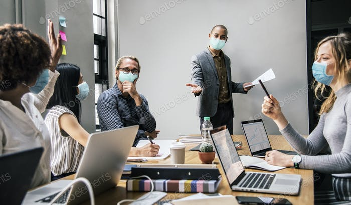 Business people wearing masks in coronavirus meeting, the new normal