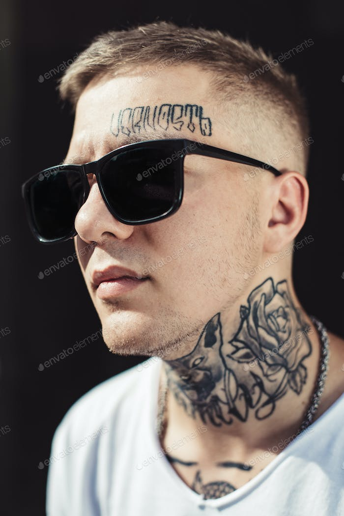 Portrait of young tattooed man
