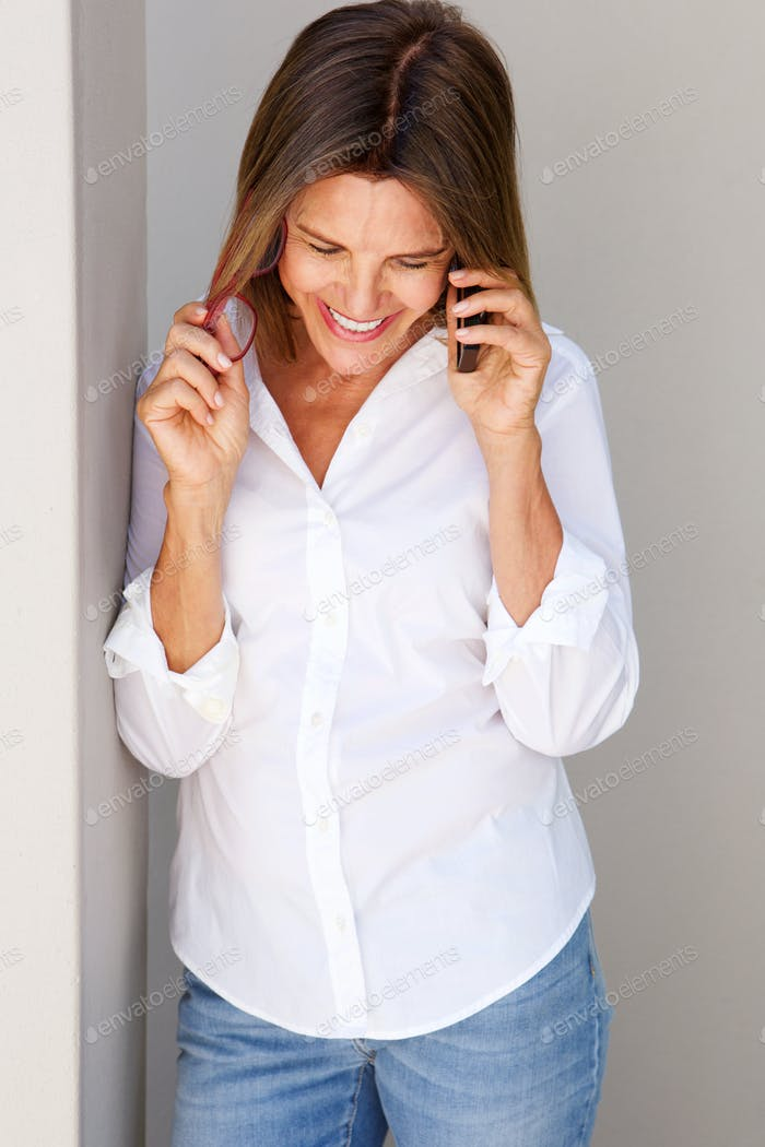 business woman smiling and talking on cellphone