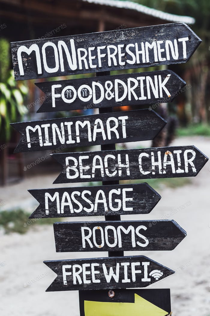 A lot of pointers on the beach: food, drink, minimart, massage, rooms, free wifi