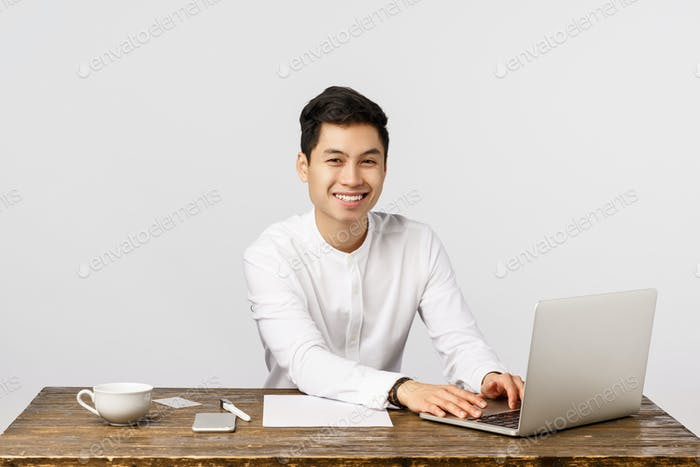 Clients, company and finance concept. Happy cheerful asian man applied for job, sitting office desk