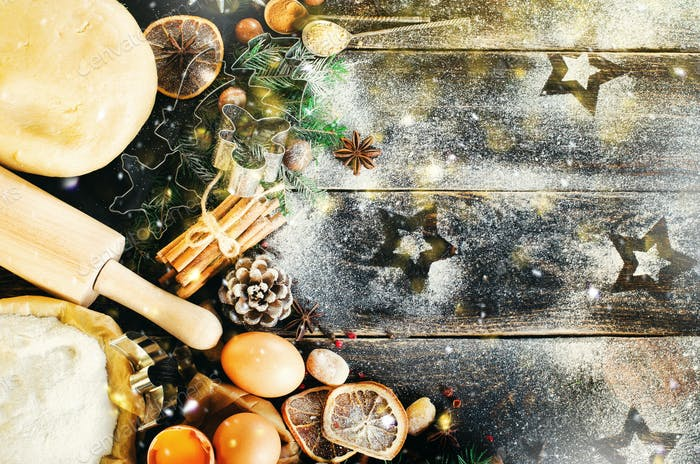 Christmas background - cones, fir tree, dough, flour, rolling pin, eggs, egg yolksover, spices, dry